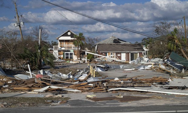 Damaged beach houses stand surrounded by debris after Hurricane Michael hit in Mexico Beach on Oct. 11, 2018. Photographer: Zack Wittman/Bloomberg