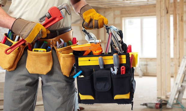Builder handyman with construction tools. Photo by kurhan/Shutterstock.com