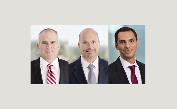 (l-r) Walter Andrews, Michael Levine, and Yaniel Abreu, with Hunton Andrews Kurth.