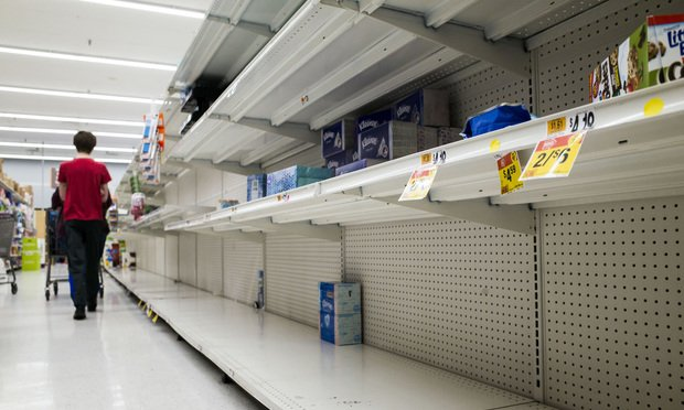 Nearly empty shelves in the cleaning products and disposable paperware aisles at a Giant supermarket in Baltimore, MD, due to the spread of the Coronavirus (Covid-19), on Thursday, March 12, 2020.