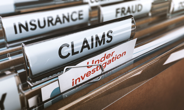 "Files with dividers that read, ""Insurance"" ""Fraud,"" ""Claims"" and ""Under investigation. Photo: Olivier Le Moal/Shutterstock.com"