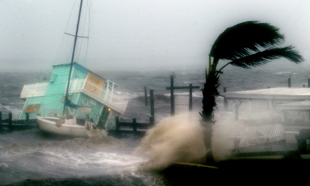 Hurricane Frances pounds houseboat against pier at Jensen Beach, which is east of Port St. Lucie, in 2004. Photo by J. Albert Diaz/ALM
