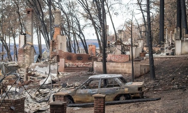 Burned-out homes and vehicles stand in Paradise, California, U.S., on Monday, November 26, 2018. The nation's deadliest wildfire in a century known as the Camp Fire that killed at least 85 people and burned over 14,000 homes has been fully contained after burning for more than two weeks, authorities said Sunday. Photographer: David Paul Morris