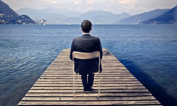 Man sitting on dock