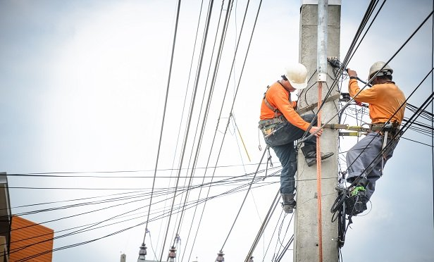 Workers on utility lines