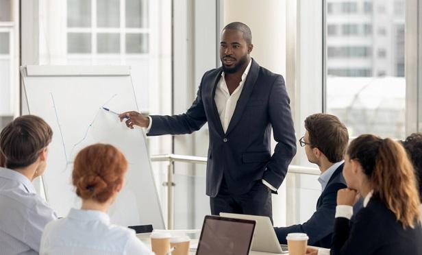 Man leading training meeting
