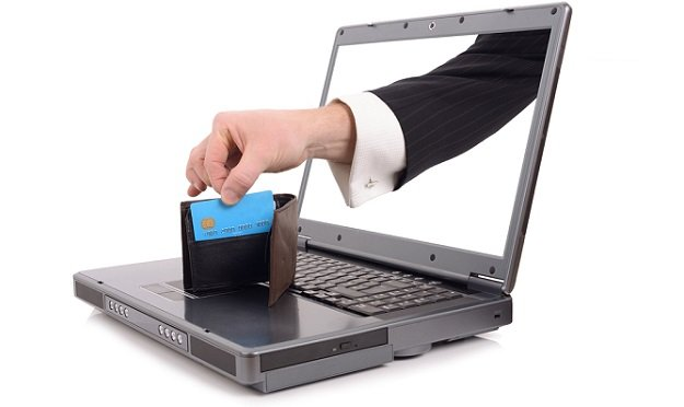 Hand reaching through computer to credit card