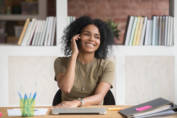woman advisor on phone in office smiling