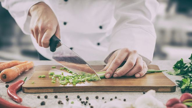 Chef cutting vegetables.