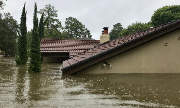 House submerged in flood water.