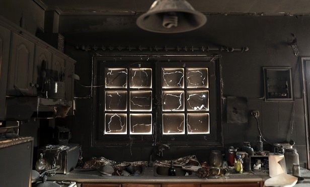 This charred kitchen was damaged during a deadly wildfire just east of Athens, Greece, in late July 2018. (Yorgos Karahalis/Bloomberg)