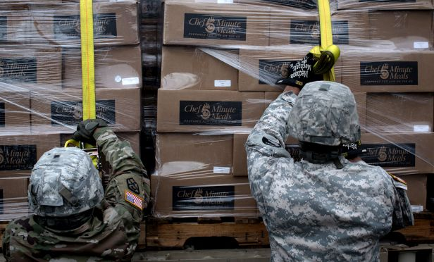 Soldiers move boxes