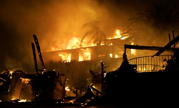 Home engulfed in fire from wildfire