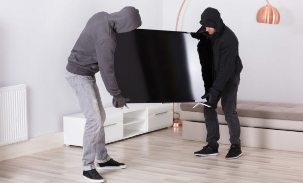 Roommates stealing a TV