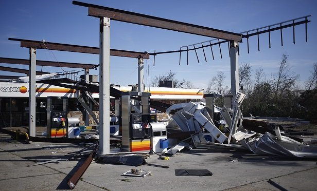 In order to trigger business income coverage, there must be direct, physical loss or damage to the property caused by a covered cause of loss, such as windstorm or hail. Thisgas station in Panama City, Fla., took just such a beating during Hurricane Michael. (Bloomberg)