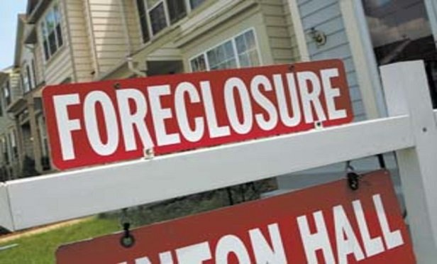 During the foreclosure process, homeowners' maintain an obligation to secure property insurance. (Newscom photo by Dennis Brack/Black Star)