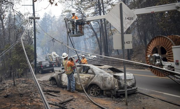 power line being repaired after wildfire.
