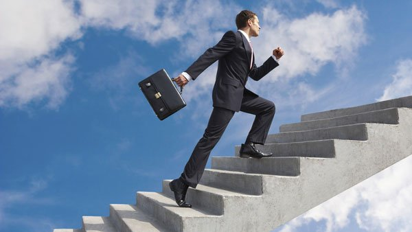 Insurance businessman climbing stairs to success