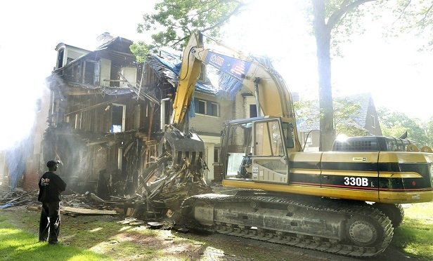 After a covered loss, demolition along with debris cleanup and removal should also be covered. (Photo: Daniel Mears/Detroit News/Newscom)