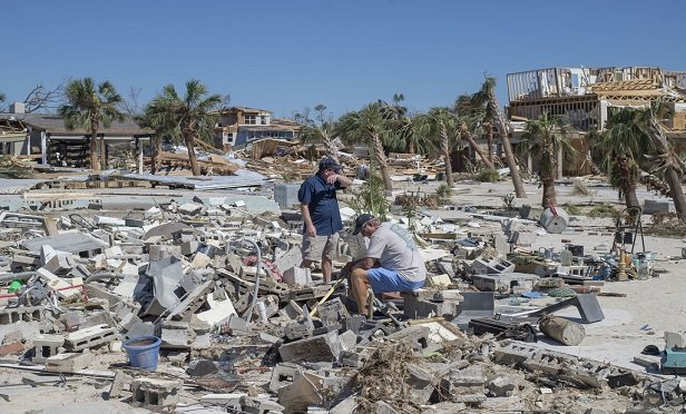 Natural disasters such as hurricanes, flooding and wildfires can strike even the most prepared homeowners and businesses. Here, residents survey debris after Hurricane Michael hit in Mexico Beach, Fla. (Zack Wittman/Bloomberg)