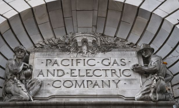 Signage is displayed on the exterior of Pacific Gas and Electric Corp. (PG&E)