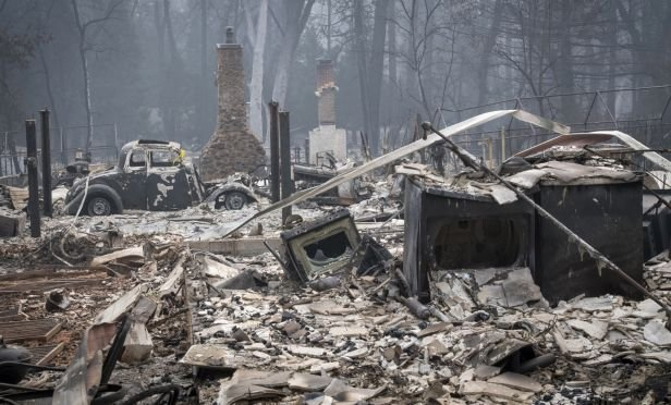 Burned-out homes and a vehicle