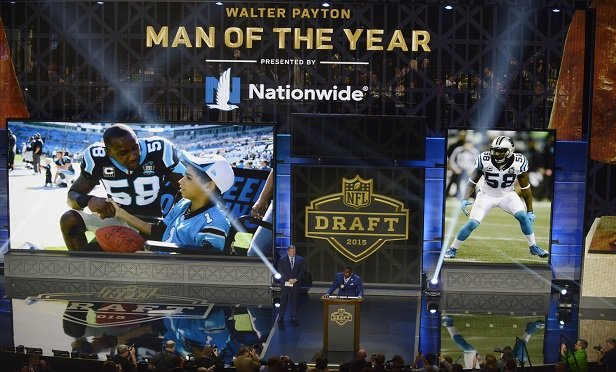 The 2014 Walter Payton Man of the Year award winner Carolina Panthers linebacker Thomas Davis speaks during the first round of the 2015 NFL Football Draft. (Photo: AP Photo/Paul Beaty)