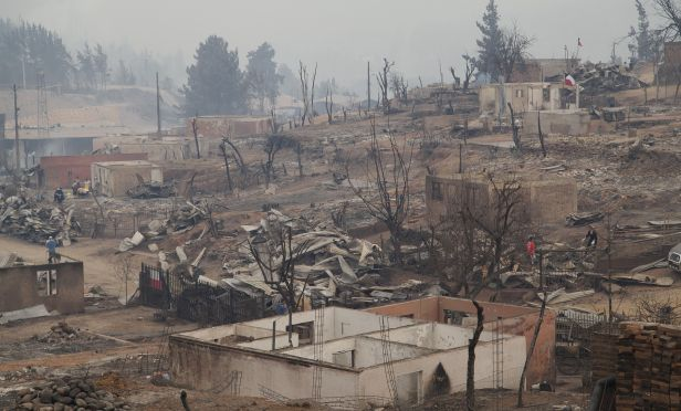 Homes destroyed by wildfires in Chile