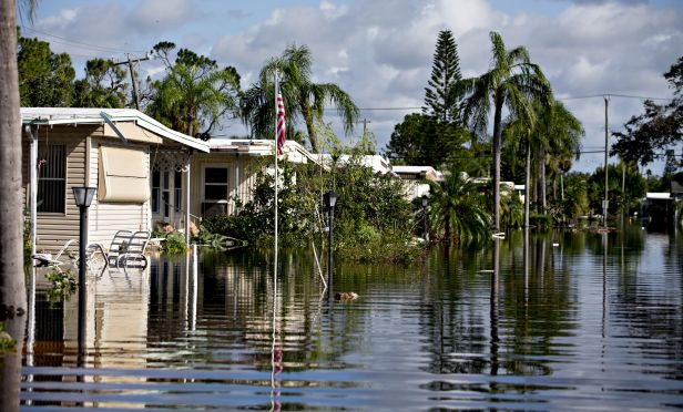 Flood water surrounds mobile homes