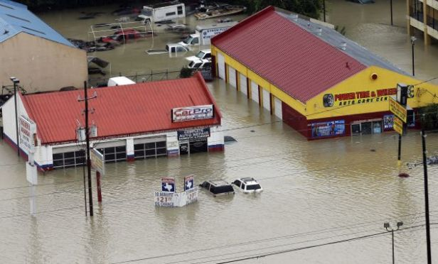 Businesses and cars are flooded.