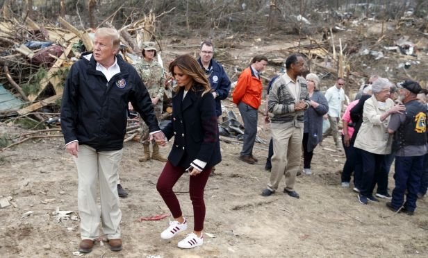 Trump visits areas of Alabama devastated by tornadoes.