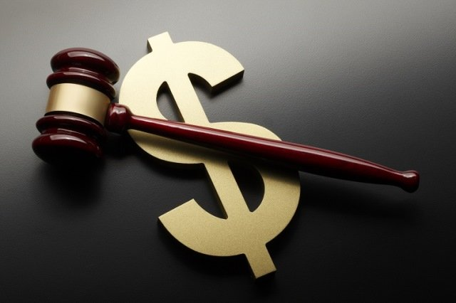 Dollar sign and gavel on black background