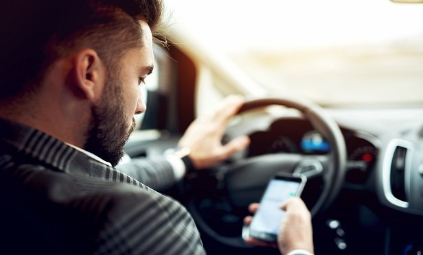 Distracted driving is more predictive of an eventual loss claim than virtually any other behavior, including speeding and braking. Those who tend to use cellphones at the wheel have 20% more insurance claims than others in the risk-pool, according to TrueMotion. (Photo: Shutterstock)