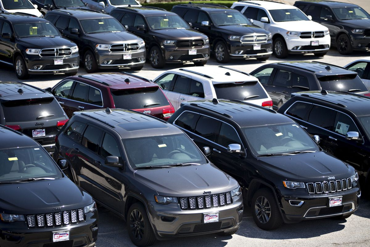 Jeep and Dodge vehicles at a Fiat Chrysler car dealership.