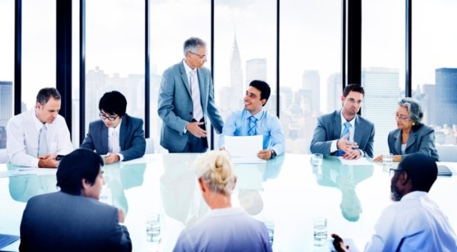 Corporate meeting in conference room diverse group of people