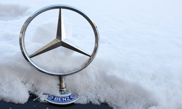 Increasingly turbulent weather in Germany's south is just another sign of Europe's largest economy getting ruffled by climate change. Here, a Mercedes-Benz star logo stands on a snow-covered automobile in Berlin, Germany. (Photographer: Adam Berry/Bloomberg News)
