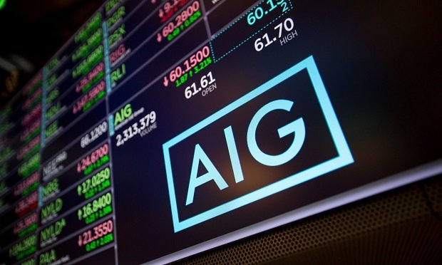 A monitor displays American International Group Inc. (AIG) signage on the floor of the New York Stock Exchange (NYSE) in New York, U.S., on Friday, February 9, 2018. (Photo: Michael Nagle/Bloomberg)