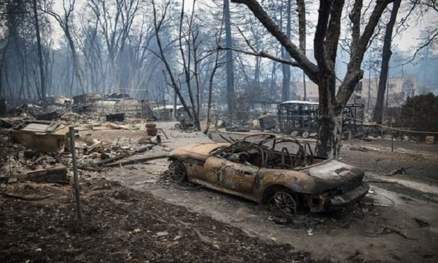 A burned-out vehicle stands during the Camp Fire in Paradise, California, U.S., on Tuesday, Nov. 13, 2018.