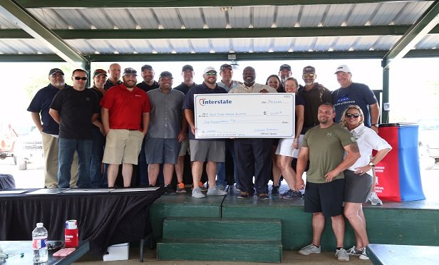 """""""At Interstate, we're in the business of helping people put their lives back together after natural and man-made disasters, so it makes sense that we would want to help veterans to reestablish their lives as well,"""" Harley Jeanise, Interstate's regional director for Texas, said in a statement. (Photo: Interstate Restoration)"""