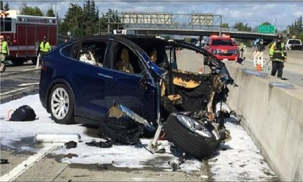 "Emergency personnel work a the scene where a Tesla electric SUV crashed into a barrier on U.S. Highway 101 in Mountain View, Calif. The test results by AAA released Thursday, Nov. 15, 2018, come after several highly publicized crashes involving Tesla vehicles that were operating on the company's system named ""Autopilot."" (Photo: KTUV via AP Photo)"