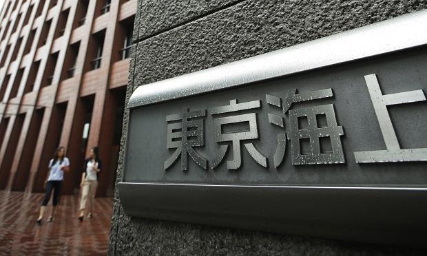 Signage for Tokio Marine & Nichido Fire Insurance Co. is displayed outside the company's headquarters building in Tokyo, Japan. (Photo: Kiyoshi Ota/Bloomberg)
