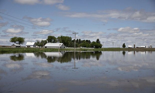 Water floods farmland in La Moille, Illinois, U.S., on Wednesday, May 29, 2019. Claims known as prevented plant pay out when farmers are unable to sow crops at all. With unceasing rain keeping farmers out of fields, growers are increasingly weighing how best to get paid and ease the impact from the bad weather and an escalating U.S.-China trade war. (Photo: Daniel Acker/Bloomberg)