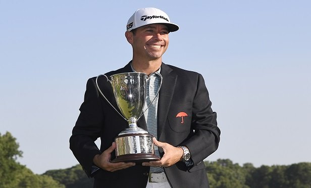Chez Reavie, winner of the Travelers Championship golf tournament poses with the trophy (Photo: AP Photo/Jessica Hill)