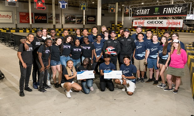 Argo Group presents a $10,000 check to two robotics teams from Long Island and Brooklyn, and $5,000 grant to a Queen's step team. (Photo: Brian Bowen)