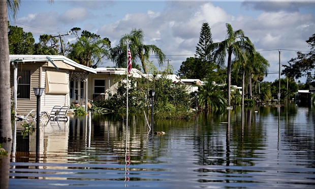 Mobile homes stand in a flooded neighborhood in Bonita Springs, Florida, U.S., on Tuesday, Sept. 12, 2017. Hurricane Irma smashed into Southern Florida as a Category 4 storm, driving a wall of water and violent winds ashore and marking the first time since 1964 the U.S. was hit by back-to-back major hurricanes. (Photo: Daniel Acker/Bloomberg)