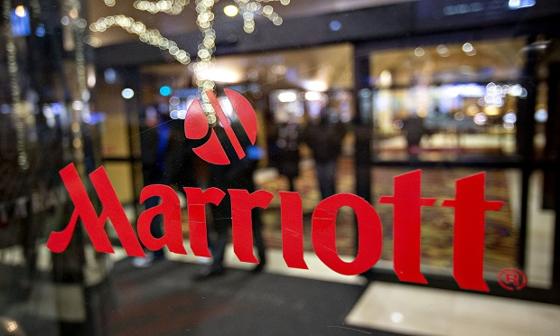 A logo is displayed on an entry door to a Marriott International hotel in Chicago, Illinois, U.S., on Friday, Nov. 30, 2018. A cyber breach in Starwood's reservation system had allowed unauthorized access to information about as many as 500 million guests since 2014. (Photo: Daniel Acker/Bloomberg)