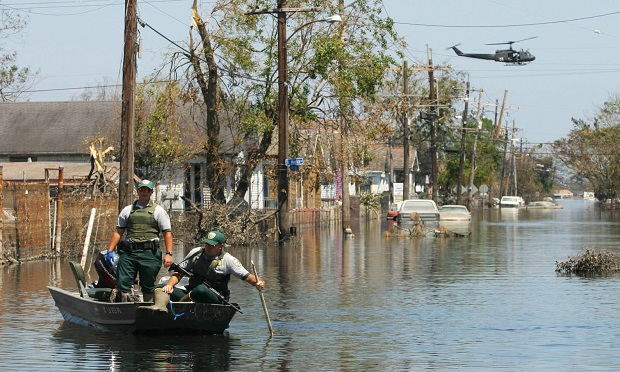 Officers from the Department of Wildlife Preservation search for flood victims in an area of St. Bernard Parish in New Orleans, Louisiana on Thursday, September 8, 2005. (Photo: Timothy Fadek/Bloomberg)