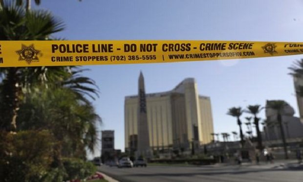 In this Oct. 4, 2017, file photo, part of Reno Ave. near South Las Vegas Blvd is blocked with police tape in the aftermath of a mass shooting in Las Vegas. (Photo: Marcio Jose Sanchez/AP)
