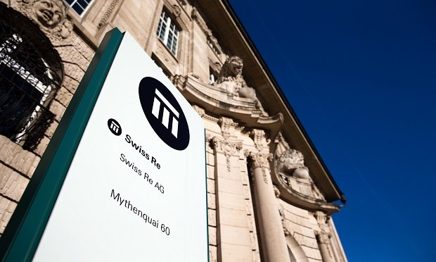 A logo sits on a sign outside Swiss Re AG's headquarters in Zurich, Switzerland. (Photo: Philipp Schmidli/Bloomberg)