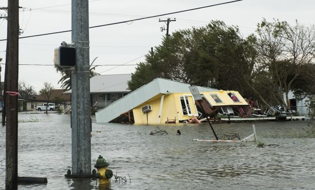 Flooded home collapsing